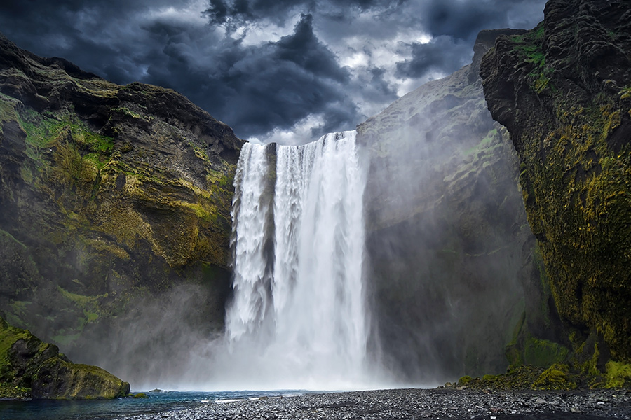 Skógafoss is shown here without its usual double rainbow, but beautiful nonetheless.